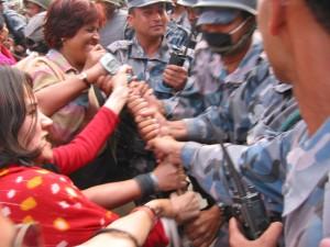 Democratic Activists tussling with the police in Baag Bazaar, Kathmandu in 2004.